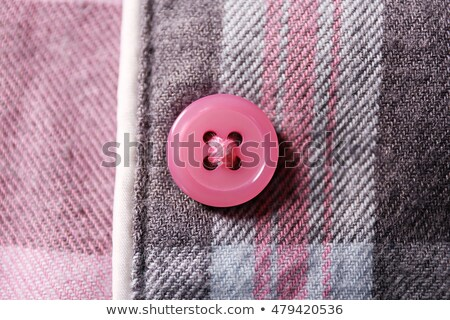 Closeup Small Buttons on White Cloth Stock photo © juniart