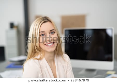 Corporate Woman Sitting at Worktable with Computer Stock photo © dash