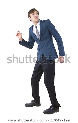surprised man in suit posing and looking up stock photo © feelphotoart