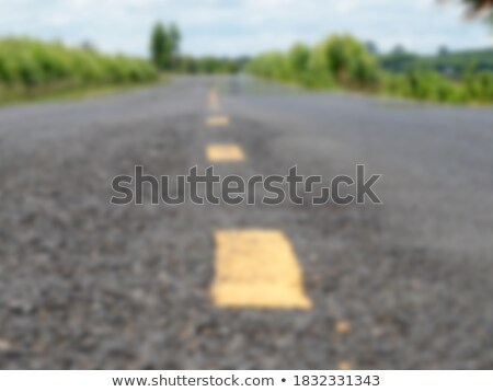 White dotted line on the Asphalt road in motion blur Stock photo © klss