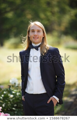 Portrait of an attractive young businessman wearing black suit. Blonde hair Stock photo © master1305