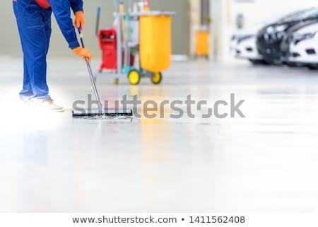Man cleaning warehouse floor with machine Stock photo © wavebreak_media