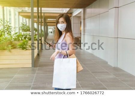 Ordinary casual woman walking down the street Stock photo © stevanovicigor