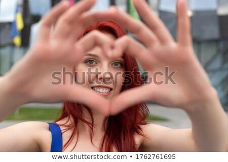 Bájos derűs nő vörös haj gyönyörű virág Stock fotó © deandrobot
