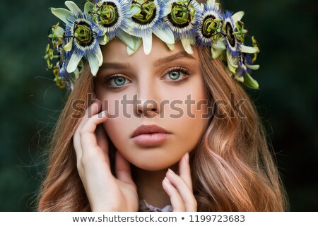 Attractive cheerful young woman in white dress and flower wreath  stock photo © deandrobot
