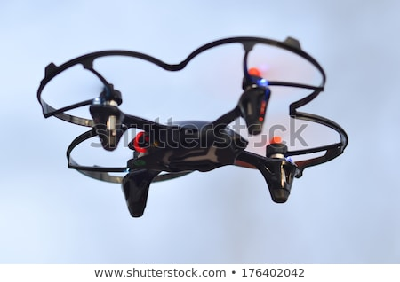 remote controlled quadcopter drone in mid air Stock photo © alex_grichenko