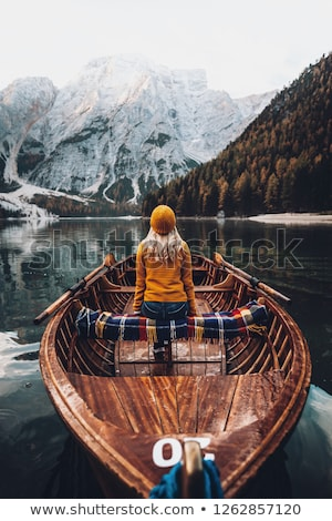 beautiful girl sitting in the boat stock photo © artfotodima