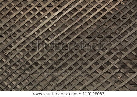 Stock photo: Worn out wooden lattice fence background