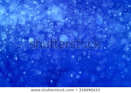 abstract blue christmas background with real snow blurred snowflakes stock photo © maxpro