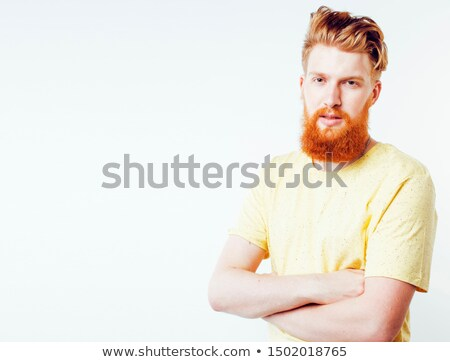 portrait of young bearded hipster guy smiling on white background close up isolated lifestyle real stock photo © iordani