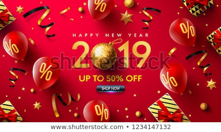 christmas festival ball with golden ribbon on red background stock photo © sarts