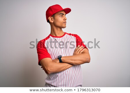 serious young african sportsman posing with arms crossed stock photo © deandrobot