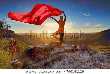 Woman Pilates Yoga balance  with sheer flowing fabric Stock photo © lovleah
