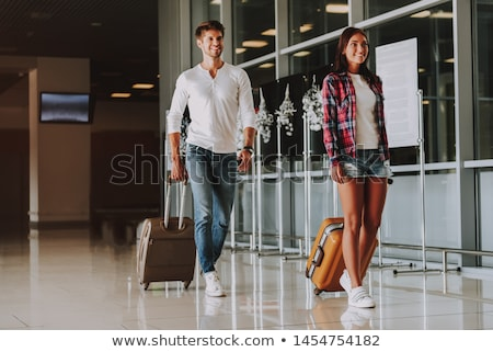 Couple walking through airport departure lounge stock photo © monkey_business