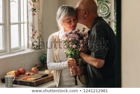 szépség · barna · hajú · köteg · virágok · lány · tavasz - stock fotó © deandrobot
