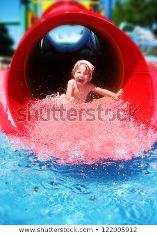girl riding down the water slide stock photo © gsermek