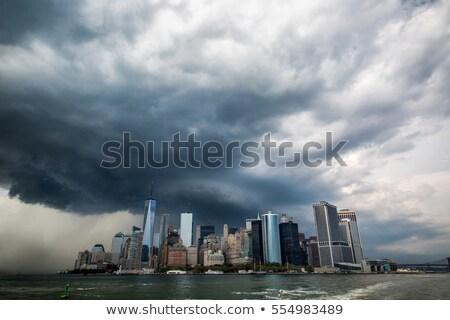 dark clouds over urban background stock photo © konradbak