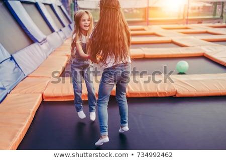 gelukkig · meisje · springen · hoog · buitenshuis · zomer - stockfoto © fotoyou