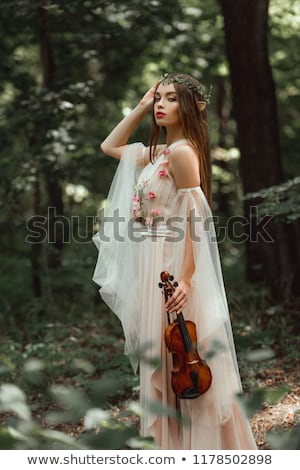 girl posing and holding a violin Stock photo © tekso