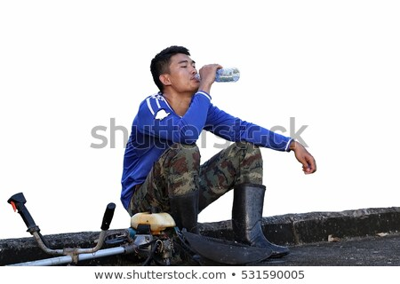 Man drinking water by lawn mover Stock photo © IS2