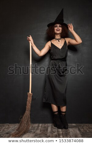 Full length image of frightening woman in halloween costume Stock photo © deandrobot