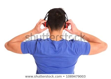 Older man listening wearing head phones Stock photo © IS2
