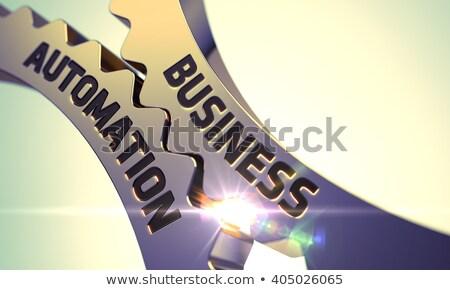 Negócio automação dourado engrenagens mecanismo brilho Foto stock © tashatuvango