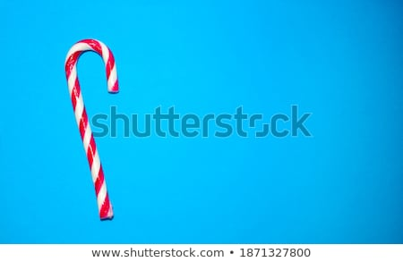 Sweet striped candy lollipop cane symbol accessory Christmas Stock photo © orensila