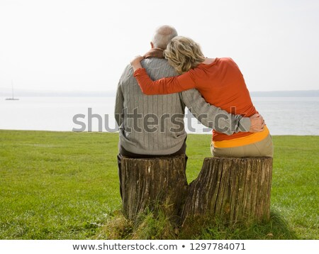 couple with arms around tree Stock photo © IS2
