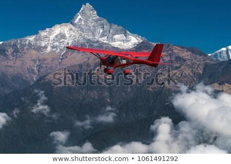 плоскости · двигатель · пропеллер · синий · облачный - Сток-фото © dutourdumonde