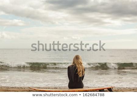 Sarışın kadın oturma kum plaj kadın seksi Stok fotoğraf © wavebreak_media
