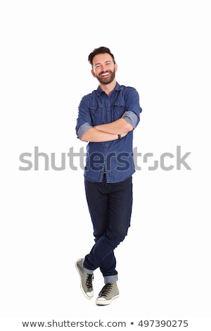 full length portrait of a relaxed smiling man stock photo © deandrobot
