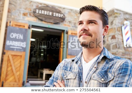 Barber standing outside shop. stock photo © monkey_business
