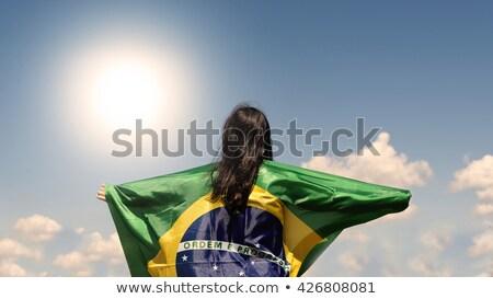 Beautiful woman holding flag of Brazil. Soccer fan Stock photo © orensila