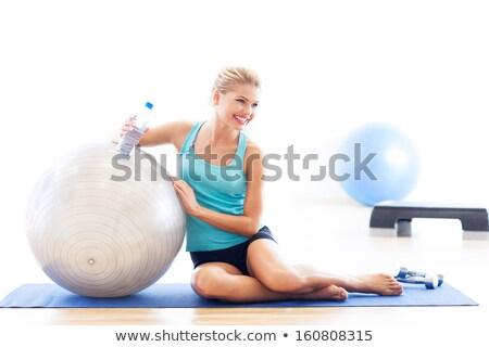 Aerobic mujer pilates pelota relajarse cantimplora Foto stock © lunamarina