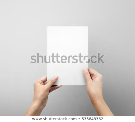 Two hands holding blank paper card stock photo © Dinga