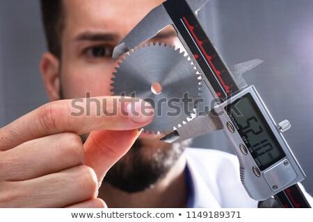 Person Measuring Golden Gear With Vernier Caliper Stock photo © AndreyPopov