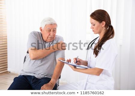 Lekarza recepta mężczyzna pacjenta ramię ból Zdjęcia stock © AndreyPopov