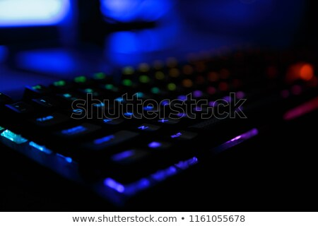 Closeup photo of workplace with led rainbow backlight gaming key Stock photo © deandrobot