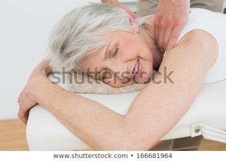 Physiotherapist Massaging Senior Man's Shoulder Stock photo © AndreyPopov