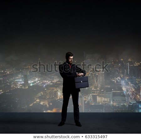 man in suit with glasses over night city lights Stock photo © dolgachov