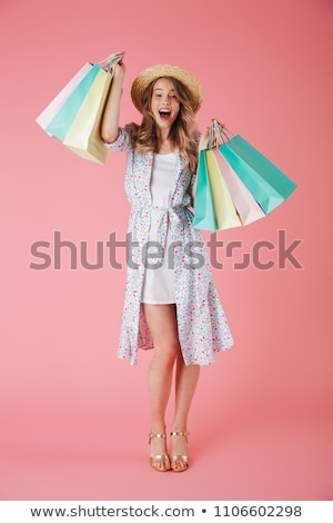 Portrait of an excited young girl in dress and straw hat Stock photo © deandrobot