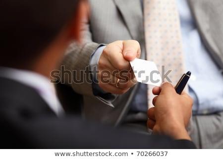 tarjeta · de · visita · primer · plano · foto · manos · negocios · hombre - foto stock © minervastock