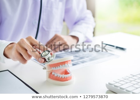 dentist doctor hands using Stethoscope to checkup tooth health,  Stock photo © snowing