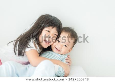 семьи · кровать · пижама · вместе · девушки - Сток-фото © lopolo