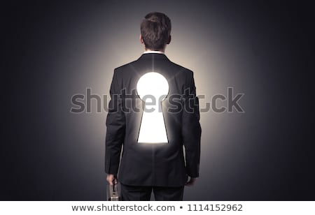 man standing with black keyhole on his back stock photo © ra2studio