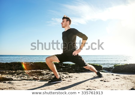 young male working out on beach, sporty man doing exercises Stock photo © galitskaya