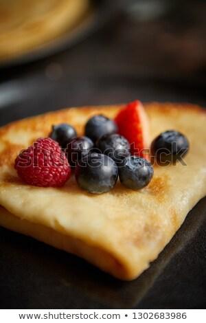 Közelkép palacsinta friss gyümölcs sötét rozsdás asztal Stock fotó © dash