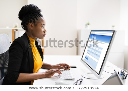 businesswomans hand filling the survey form on laptop stock photo © andreypopov