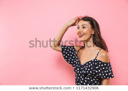 Happy brunette woman in dress take off sunglasses Stock photo © deandrobot
